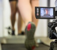 image of video camera recording a young man using a trade mil