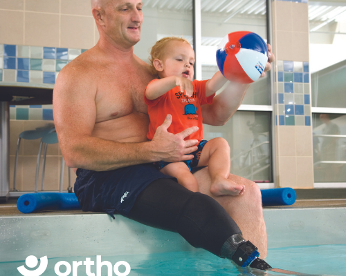 man with prosthetic with Limblogic in swimming pool